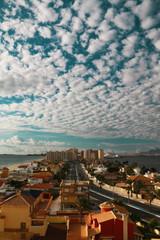 View of La Manga left Arenal beach, in the center, avenue Gran Via de la Manga, and on the right the Mar Menor