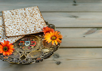 Pesah celebration concept (Jewish Passover holiday). Vintage traditional seder plate and matzoh.