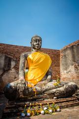 Smiling buddha with orange cloth