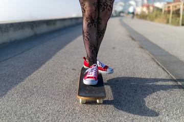 Close-up of a girl skating a skate at the street