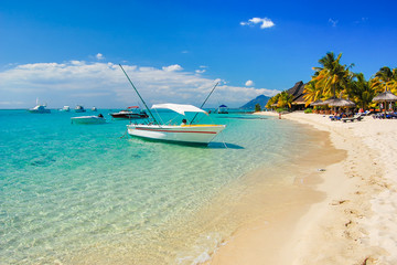 MAURITIUS ISLAND - SEP 26, 2010: Boat anchoring on beautiful tropical beach on sunny beautiful day....