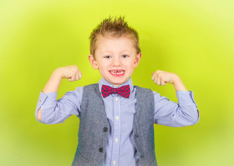smiling child who shows muscles