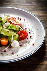 Caprese salad on wooden background