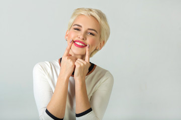 beautiful young girl with short hair style smiling on white background