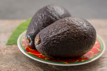 Fresh dark green organic avocado with leaf