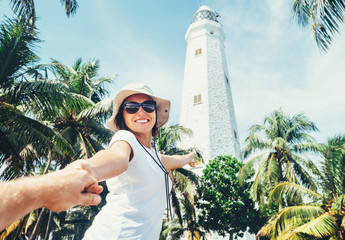 Dondra lighthouse in Sri Lanka: woman traveler take for hand her boyfreind and goes to lighthouse