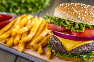 Hamburger on sesame seed bun with fries