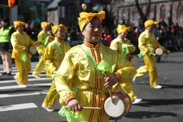 People celebrate the Lunar New Year of the Dog at the Flushing Lunar New Year Parade in Queens, New York