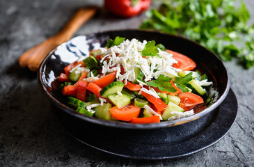 Shopska Salad - Bulgarian salad with tomato, cucumber, pepper, scallion, parsley and cheese