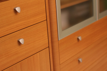 Elegant classic woodenwardrobe drawer front with metal handles