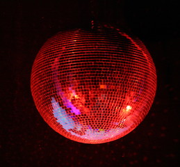 night club lighting red mirror-ball over black
