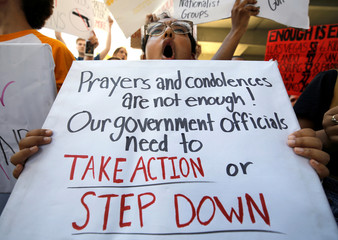 A student protester chants at a rally calling for more gun control three days after the shooting at Marjory Stoneman Douglas High School, in Fort Lauderdale