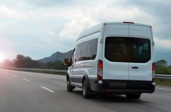 minibus speeding on highway in mountains