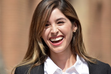 Laughing Adult Colombian Business Woman Wearing Suit