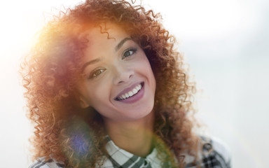 Portrait of a beautiful young woman with curly hair.