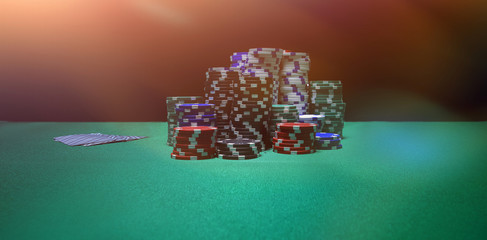 Stacked casino chips arranged on poker table