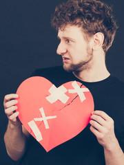 Unhappy man with broken heart.