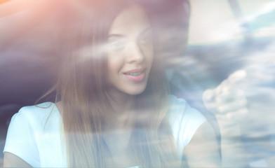 sad portrait of a woman outside a car window