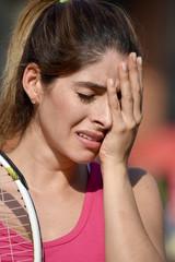 Athlete Girl Under Stress With Tennis Racket