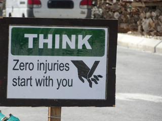 """Safety signage """"THINK"""" at the construction site. Safety signage used to make sure workers aware activities ahead and to avoid accident happen."""