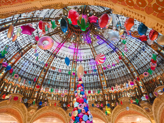 Interior of shopping center Galeries Lafayette located boulevard Haussmann in Paris.