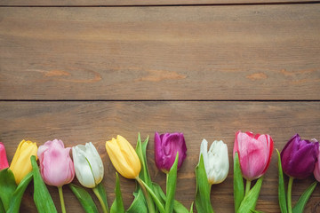 Traditional objects for mother's day isolated on wooden background tulips at the bottom