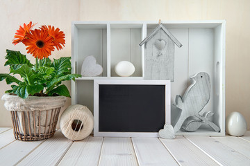 Springtime background with spring decorations. Display cabinet with Easter decorations, space