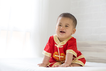 Baby boy wearing red dress for Chinese New Year