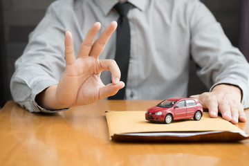 Consumer preparing documents for car loan application with the bank