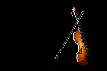 Violin isolated on black with bow