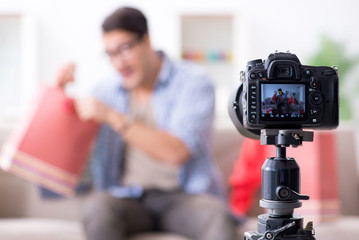 Male fashion blogger recording video for vlog