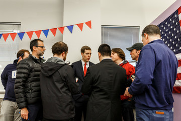 Reporters encircle Congressional candidate Conor Lamb following a campaign event in Carnegie