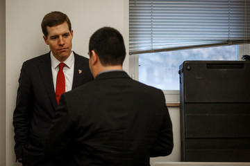 A reporter questions Congressional candidate Conor Lamb following a campaign event in Carnegie