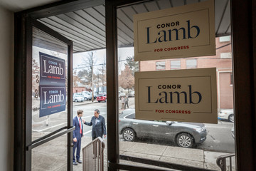 """Congressional candidate Conor Lamb meets Jon """"Bowzer"""" Bauman outside of a campaign event in Carnegie"""