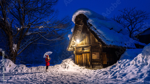 Wall mural Young woman in Shirakawa-go village in winter, UNESCO world heritage sites, Japan.