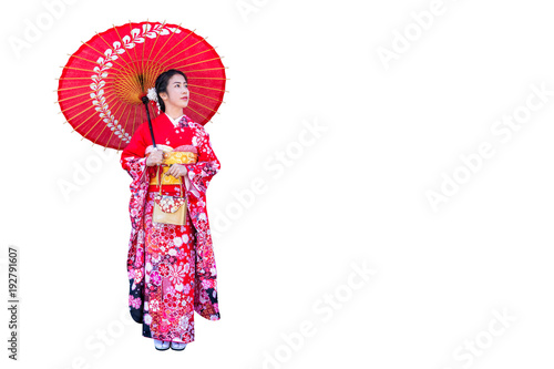 Wall mural Asian woman wearing japanese traditional kimono on white background.