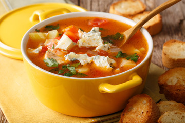 Chicken buffalo soup with vegetables and blue cheese close-up in a saucepan. horizontal