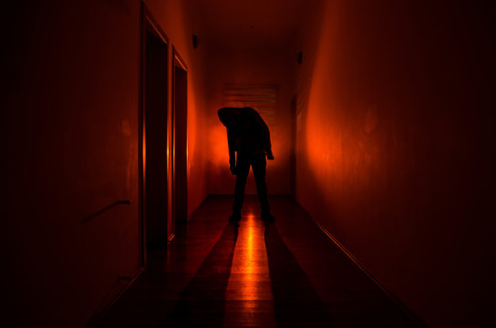 Dark corridor with cabinet doors and lights with silhouette of spooky horror man standing with different poses.