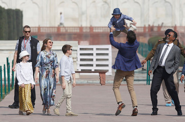Canadian Prime Minister Justin Trudeau plays with his son Hadrien as his wife Sophie Gregoire, daughter Ella Grace and son Xavier look on during their visit to the Taj Mahal in Agra