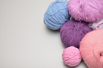 Colored balls of yarn. Top view. Shades of  violet, purple, crimson, blue.  Yarn for knitting.