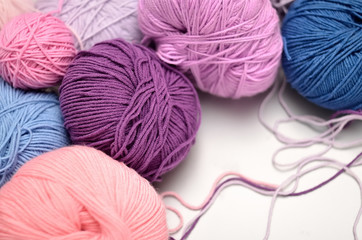 Colored balls of yarn. Shades of  violet, purple, crimson, blue.  Yarn for knitting.