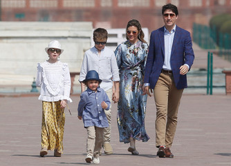 Canadian Prime Minister Justin Trudeau with his wife Sophie Gregoire, daughter Ella Grace and sons Hadrien and Xavier walk during their visit to the Taj Mahal in Agra