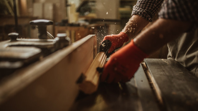 carpenter works with manual and electric equipment