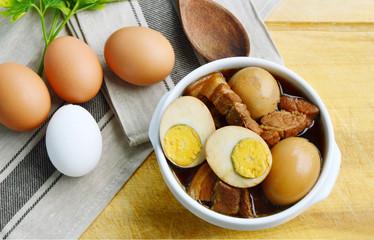 Eggs Stewed or Thai name is khai phalo muu saam chan on wooden background