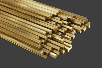 Brass metal, rods of brass. Rolled metal products. Isolated on gray background, clipping path included. 3d illustration.