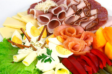 Various mixed meat and vegetable appetizers on white background