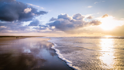 Walking along the beach during sunset in IJmuiden the Netherlands,