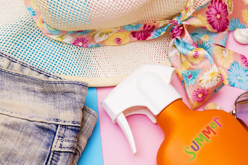 holiday accessories, sun hat and suntan lotion