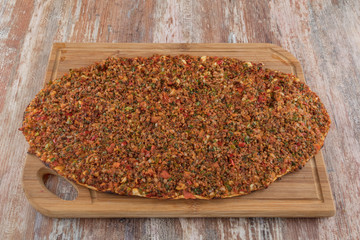 Turkish Food: lahmacun closeup on a wooden table.