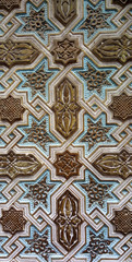 close up detail of colorful geometric patterns of an Islamic mosaic facade